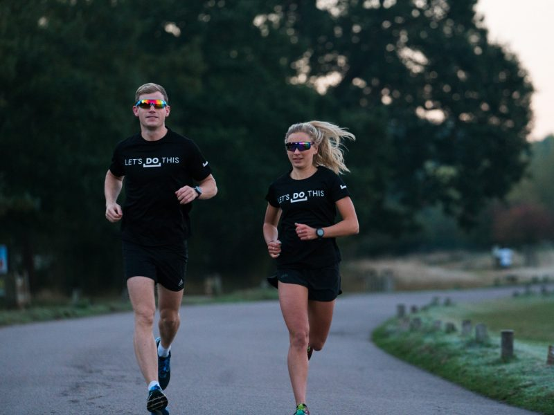 Man and woman running in Richmond Park