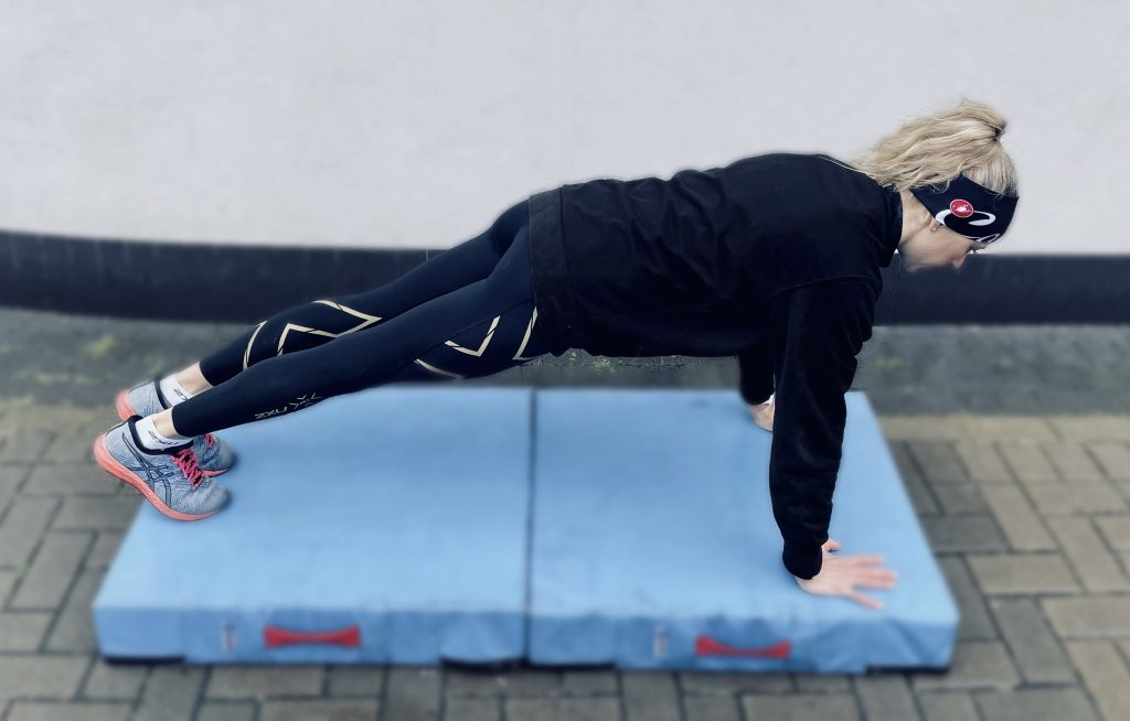 Woman doing a plank core exercise.