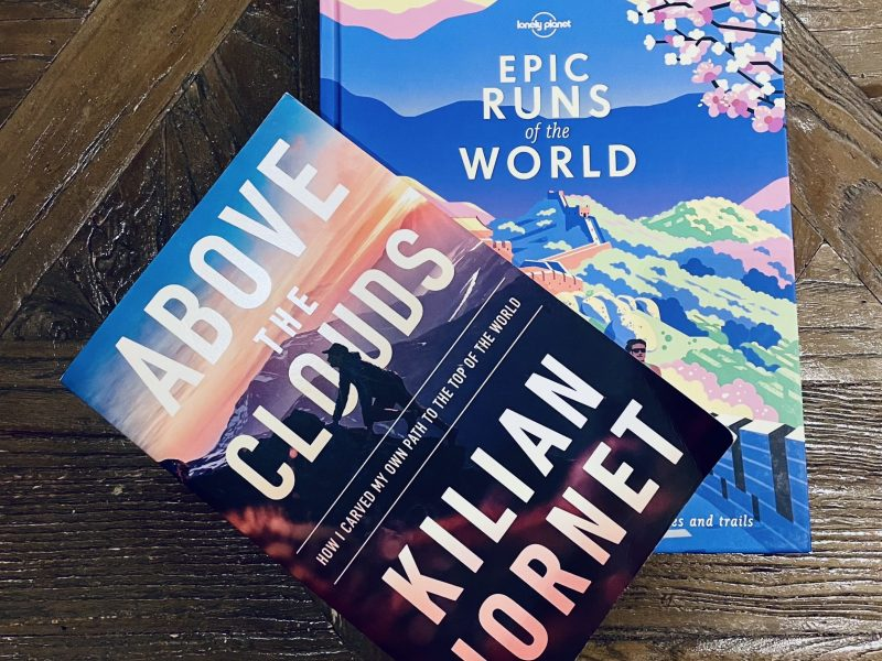 Two running books on a coffee table.