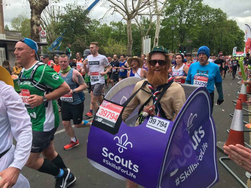 Sean Conway running the London Marathon dressed as a scout badge